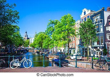 Beautiful canal and traditional bikes in old city of...