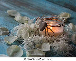 Beautiful candle and rose on wooden background. Close up