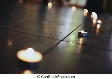 beautiful candles in a shape of a heart on the floor, wedding ceremony in a restaurant
