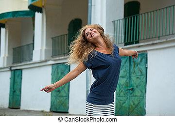 woman dances on the street