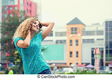 carefree woman dances on the street