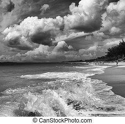 Beautiful caribbean beach with dramatic sky