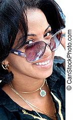 Beautiful caribbean brunette with sunglasses posing