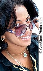 Beautiful caribbean brunette with sunglasses posing