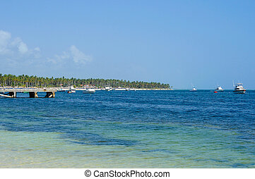 Beautiful Carribean Coastline, Beach and Sea. Boats and jetty also visible