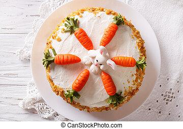 Beautiful carrot cake with candy bunny close-up. horizontal top view