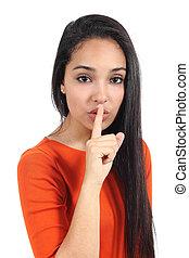 Beautiful casual muslim woman asking for silence