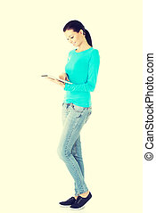 beautiful casual woman holding a tablet.