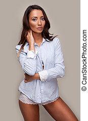 Beautiful casual woman in shirt and panties