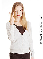 Beautiful casual woman is showing victory sign, two fingers.