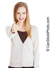 Beautiful casual woman pointing on you.