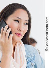 Beautiful casual woman using mobile phone in office