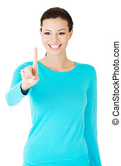 beautiful casual woman with pointing finger.