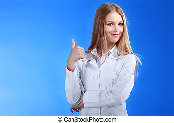 Beautiful caucaisn nurse or doctor showing ok gesture. Isolated
