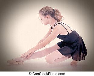 Beautiful caucasian ballerina stretching. Dramatic portrait. Clipping path.