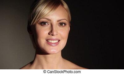 Beautiful caucasian blonde woman smiling at camera.