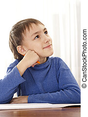 Beautiful Caucasian boy sitting