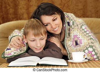 Beautiful Caucasian boy with his mom sitting