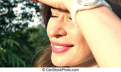Beautiful caucasian brunette girl looking at skysrapers, 4K pan and zoom shot