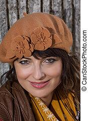 Beautiful caucasian brunette with brown cap