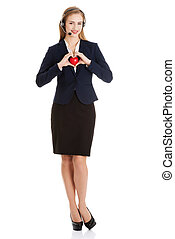 Beautiful caucasian business woman at call center holding heart. Isolated on white.