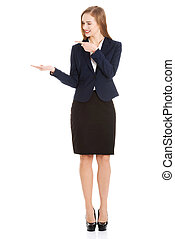 Beautiful caucasian business woman pointing on copy space on her side. Isolated on white.