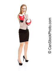 Beautiful caucasian business woman with boxing gloves.