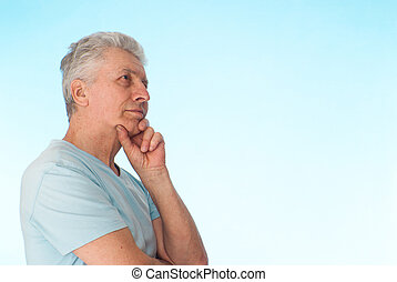 Beautiful Caucasian elderly male on a light background