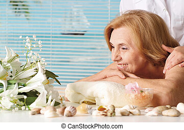 Beautiful Caucasian elderly woman at a reception in the spa...