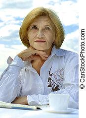 Beautiful Caucasian elderly woman sitting