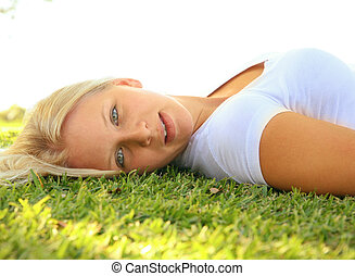 Beautiful Caucasian Female Lay Side On Grass