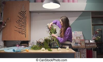 Beautiful caucasian girl working as a florist, small business owner. High quality 4k footage