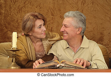 Beautiful Caucasian good couple of old people sitting