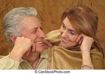 Beautiful Caucasian joy couple of aged people sitting