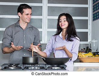 Beautiful caucasian love couple cooking at kitchen