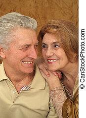 Beautiful Caucasian nice couple of aged people sitting