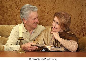Beautiful Caucasian nice couple of elderly people sitting