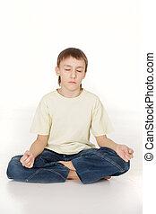 Beautiful Caucasian teenager sitting meditating