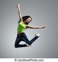 beautiful caucasian woman dancer jumping