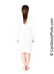 Beautiful caucasian woman in bathrobe standing back to the camera, isolated on white background