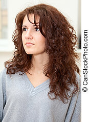 Beautiful Caucasian woman portrait with long curly hair