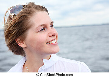 Beautiful Caucasian woman with sunglasses in white shirt. Copy space