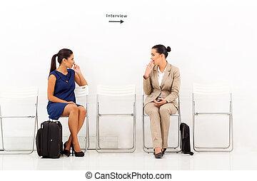 caucasian women chatting before employment interview