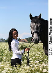 Beautiful caucasian young woman and horse portrait at the...