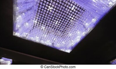 Beautiful ceiling chandelier - On a background of a black...