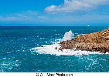 Beautiful cerulean sea and the rock