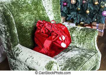 beautiful chair with Christmas gift bag