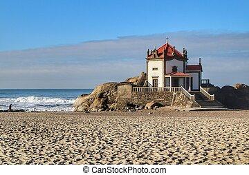 Beautiful chapel in the sea called Senhor da Pedra in Porto