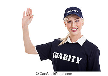 charity worker waving - beautiful charity worker waving over...