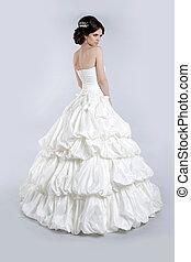 Beautiful charming bride in wedding luxurious dress....